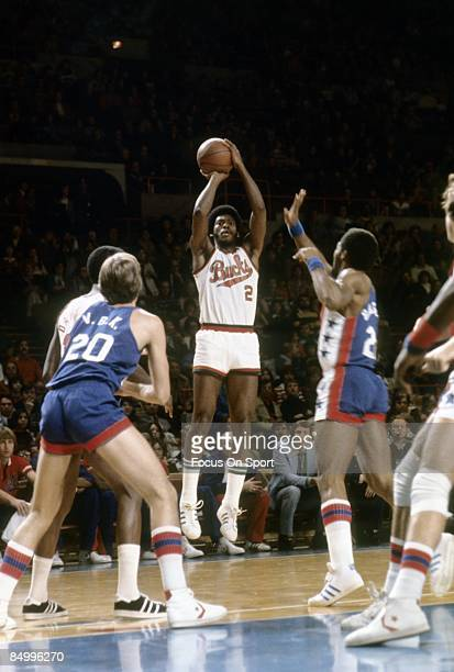 MILWAUKEE WI CIRCA 1970's Junior Bridgeman of the Milwaukee Bucks in action shooting from the outside over Tim Bassett of the New Jersey Nets during...