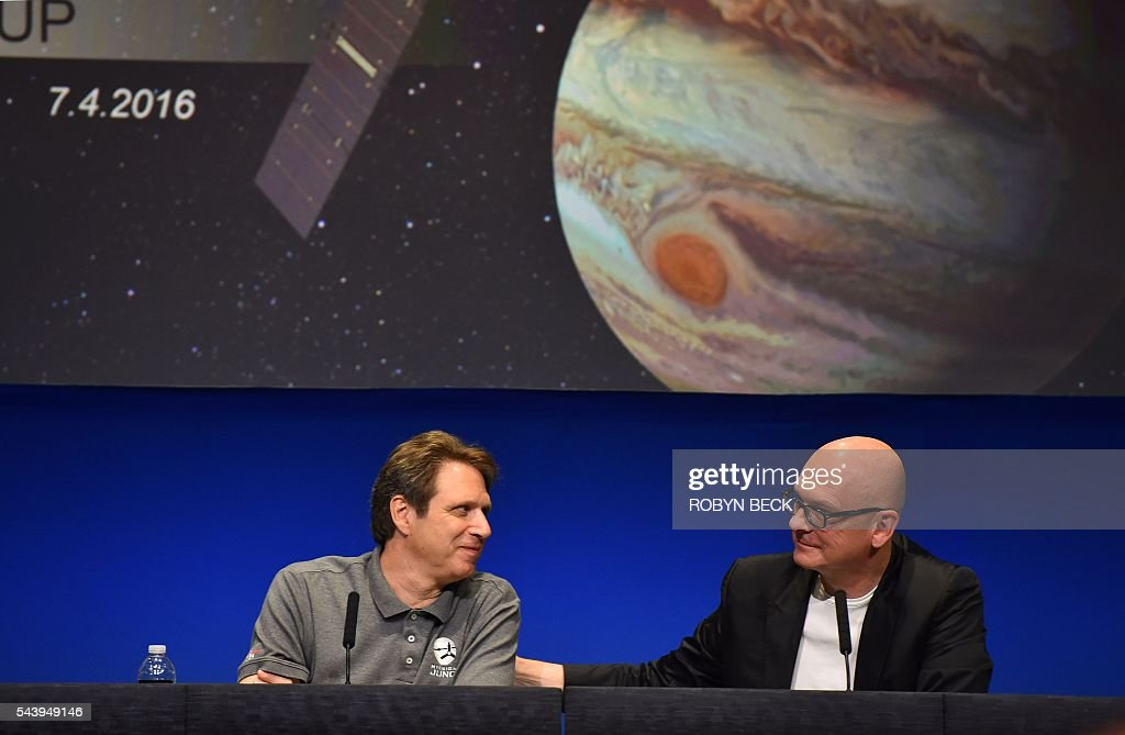 NASA's Juno Mission Principal Investigator Scott Bolton (L) and Robert Kondrk(R), Apple vice president for Content and Media Apps, speak at a press conference at the Jet Propulsion Laboratory (JPL) in Pasadena, California, June 30, 2016 to announce 'Destination: Juno,' a collaboration between NASA and Apple to bring 'exploratory' music inspired by space from artists such as Brad Paisley, Corinne Bailey Rae, GZA, Jim James featuring Lydia Tyrell, Trent Reznor & Atticus Ross, Weezer and Zoé to Apple Music and iTunes listeners. The Juno spacecraft is scheduled to enter Jupiter's orbit on July 4, 2016 after a five years voyage to the fifth planet from the sun. / AFP / Robyn Beck