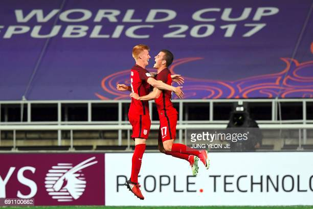 USA's Justen Glad celebrates a goal with teammate Brooks Lennon during their U20 World Cup round of 16 football match between the US and New Zealand...