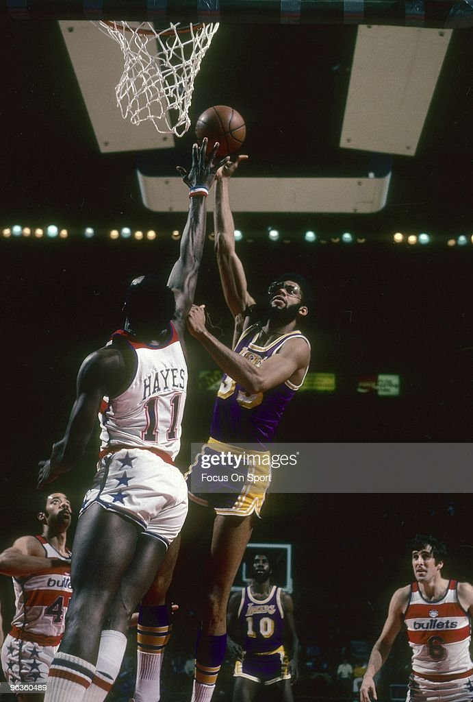 BALTIMORE MD CIRCA 1980's Kareem AbdulJabbar of the Los Angeles Lakers shoots over Elvin Hayes of the Capital Bullets during a circa 1980's NBA...