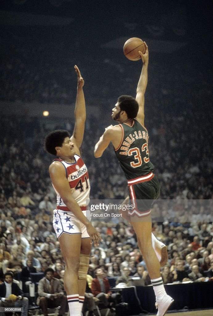 BALTIMORE, MD - CIRCA 1970's: <a gi-track='captionPersonalityLinkClicked' href=/galleries/search?phrase=Kareem+Abdul-Jabbar&family=editorial&specificpeople=206219 ng-click='$event.stopPropagation()'>Kareem Abdul-Jabbar</a> #33 of the Milwaukee Bucks shoots over <a gi-track='captionPersonalityLinkClicked' href=/galleries/search?phrase=Wes+Unseld&family=editorial&specificpeople=212864 ng-click='$event.stopPropagation()'>Wes Unseld</a> #41 of the Washington Bullets during an early circa 1970's NBA basketball game at the Baltimore Coliseum in Baltimore, Maryland. Abdul-Jabbar played for the Bucks from 1969 - 75.