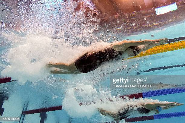 CAMERA USA's Katie Ledecky and Russia's Veronika Popova compete in the semifinals of the women's 200m freestyle swimming event at the 2015 FINA World...