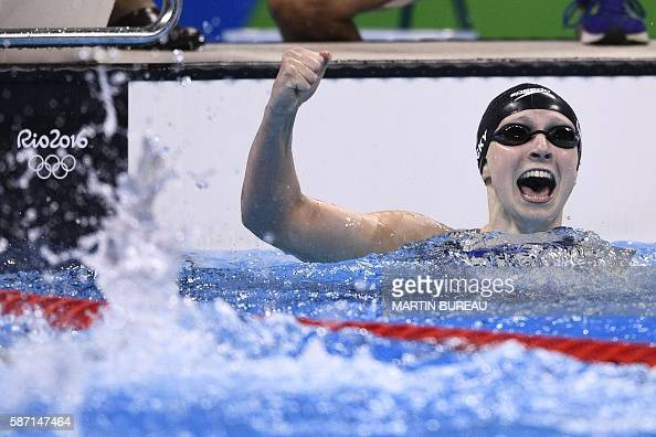 USA's Katie Ledecky celebrates after she broke the World Record in the Women's 400m Freestyle Final during the swimming event at the Rio 2016 Olympic...