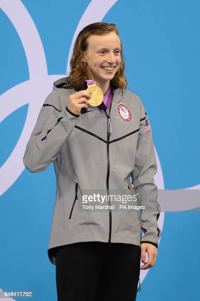 USA's Katie Ledecky celebrates with her gold medal following the presentation ceremony for the Women's 800m Freestyle at the Aquatics Centre in the...