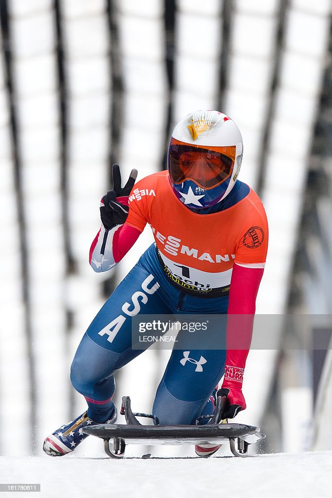 USA's Katie Uhlaender celebrates after taking second place in the Women's Skeleton competition in the FIBT Bob & Skeleton World Cup at the Sanki Sliding Centre, some 50 km from Russia's Black Sea resort of Sochi, on February 16, 2013. With a year to go until the Sochi 2014 Winter Games, construction work continues as tests events and World Championship competitions are underway.
