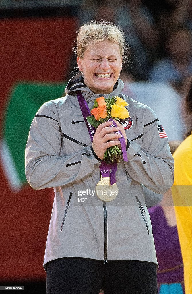 USA's <a gi-track='captionPersonalityLinkClicked' href=/galleries/search?phrase=Kayla+Harrison&family=editorial&specificpeople=7179048 ng-click='$event.stopPropagation()'>Kayla Harrison</a> smiles while on the podium after being presented the Gold Medal for her victory over Great Britain's Gemma Gibbons in the Judo Women's 78 kg division at the ExCeL Centre during the 2012 Summer Olympic Games in London, England, Thursday, August 2, 2012.