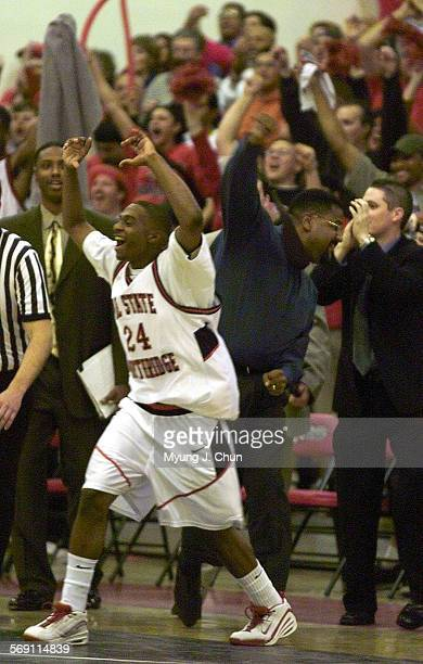 CSUN's Keith Jackson rushes the court as coach Bobby Braswell throws his fist in the air following their win over Eastern Washington Saturday night...