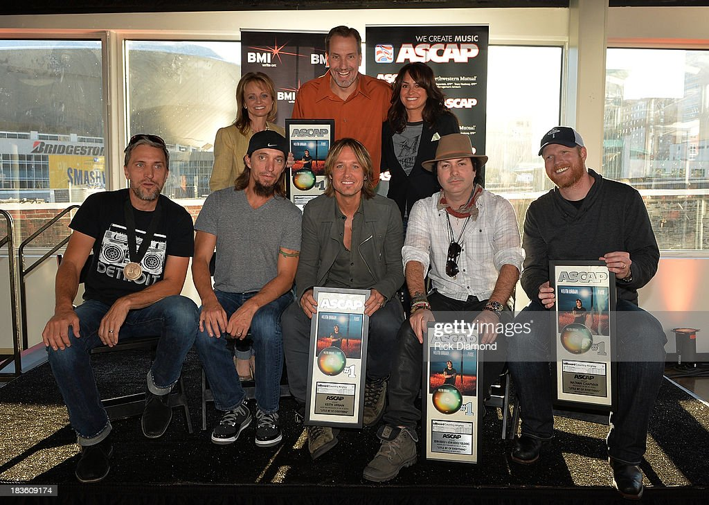 ASCAP's Kele Currier, Sony ATV Music Publishing's Tom Luteran, and ASCAP's LeAnn Phelan; (front row, l-r): co-writers Brett and Brad Warren, KU, co-writer Kevin Rudolf, and producer Nathan Chapman.Keith Urban, BMI & ASCAP Celebrates No. 1 Song 'Little Bit Of Everything' at Aerial In Nashville on October 7, 2013 in Nashville, United States.