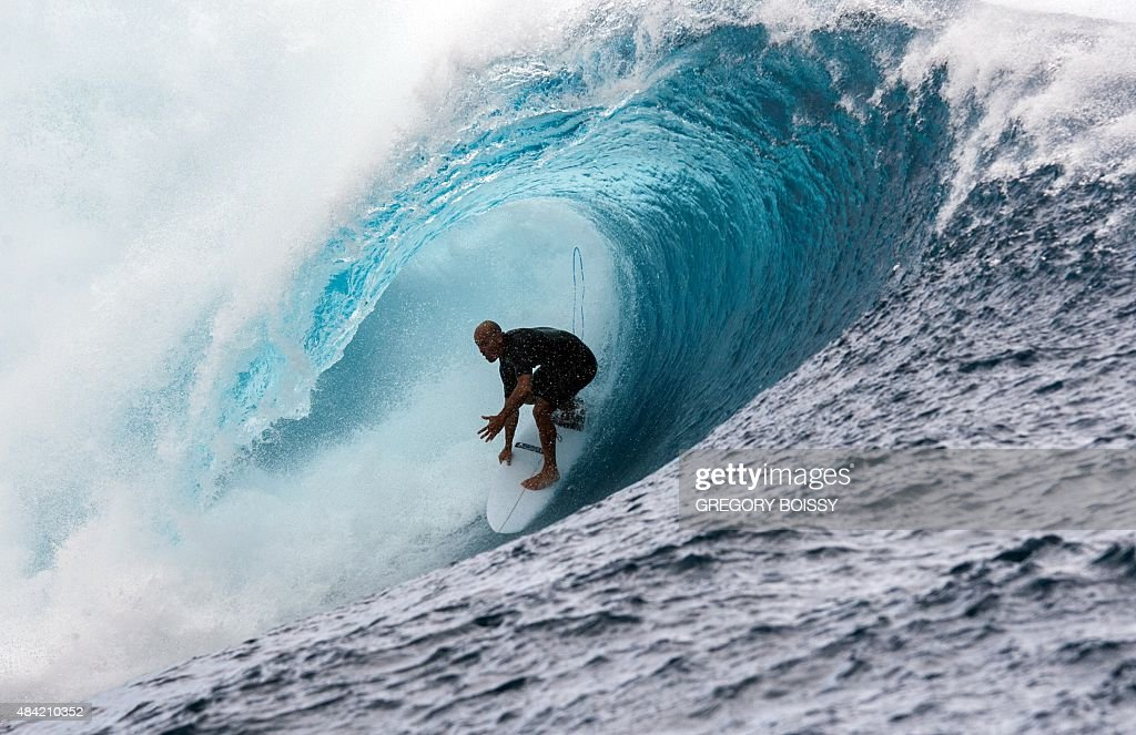 USA's Kelly Slater competes in the 2015 Billabong Pro Tahiti World Surf league tour no7 along the Teaupoo coast western Tahiti on August 15 2015...