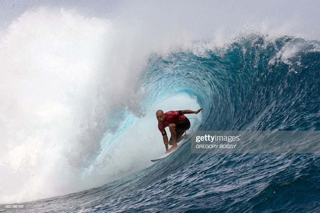 USA's Kelly Slater competes in the 2015 Billabong Pro Tahiti World Surf league tour n°4 along the Teahupo'o coast western of the French polynesia...
