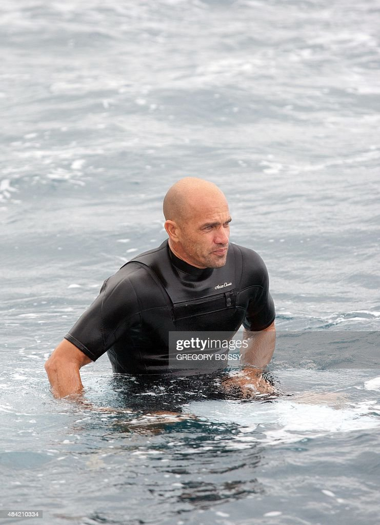 USA's Kelly Slater sits on his board as his competes in the 2015 Billabong Pro Tahiti World Surf league tour no7 along the Teaupoo coast western...