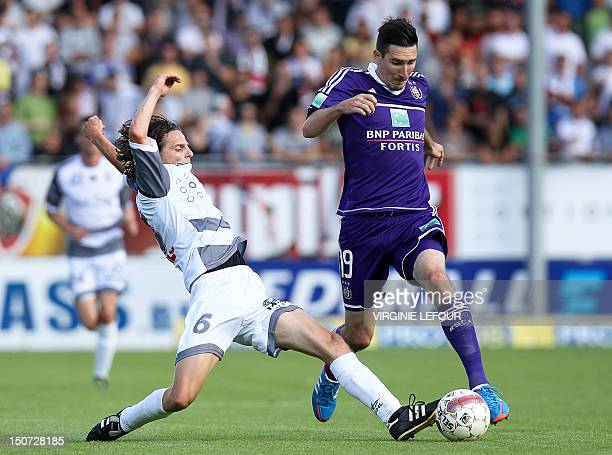OHL's Kenneth Van Goethem vies with Anderlecht's Sacha Kljestan during the Jupiler Pro League match between OHL Oud HeverleeLeuven and RSCA...