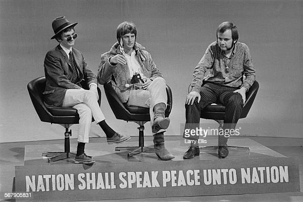 DJ's Kenny Everett Emperor Rosko and John Peel on a stage emblazoned with the BBC motto 'Nation shall speak peace unto Nation' prior to the launch of...