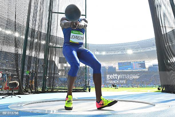 USA's Kibwe Johnson competes in the Men's Hammer Throw Qualifying Round during the athletics event at the Rio 2016 Olympic Games at the Olympic...