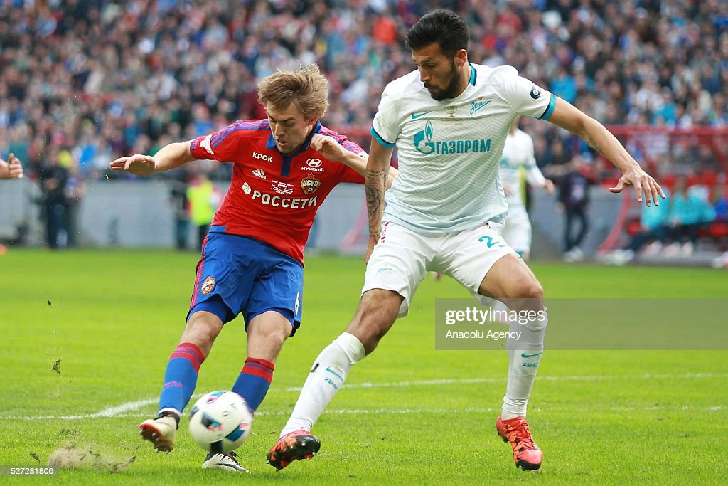 CSKA's Kirill Panchenko (L) and Zenit's Ezequiel Garay (R) fight for the ball during Russian Cup final match between CSKA Moscow vs Zenit St. Petersburg at Kazan Arena in Kazan, Russia on May 02, 2016.