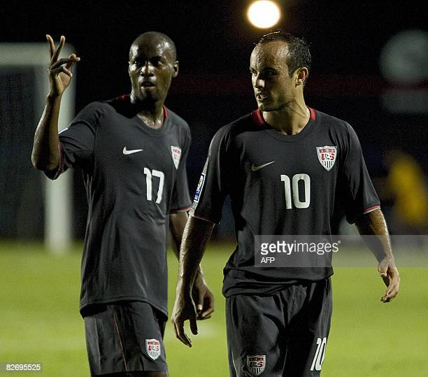 US's Landon Donovan and Bradley Damascus celebrate their victory at the end of their FIFA World Cup South Africa2010 qualifier football match against...