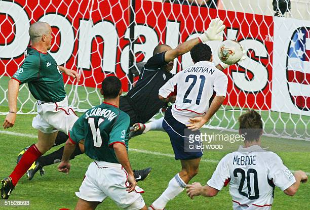 USA's Landon Donovan scores off a header in the 65th minute past an outstretched Oscar Perez in goal for Mexico 17 June 2002 at the Jeonju World Cup...