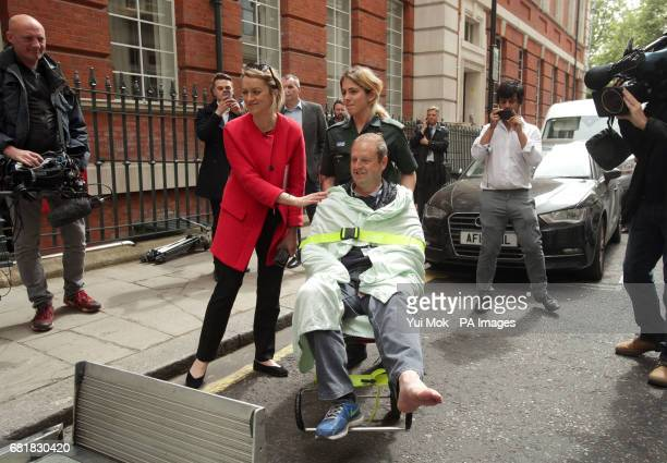 BBC's Laura Kuenssberg comforts her her colleague BBC cameraman Giles Wooltorton after the car carrying Jeremy Corbyn ran over his foot as it arrived...