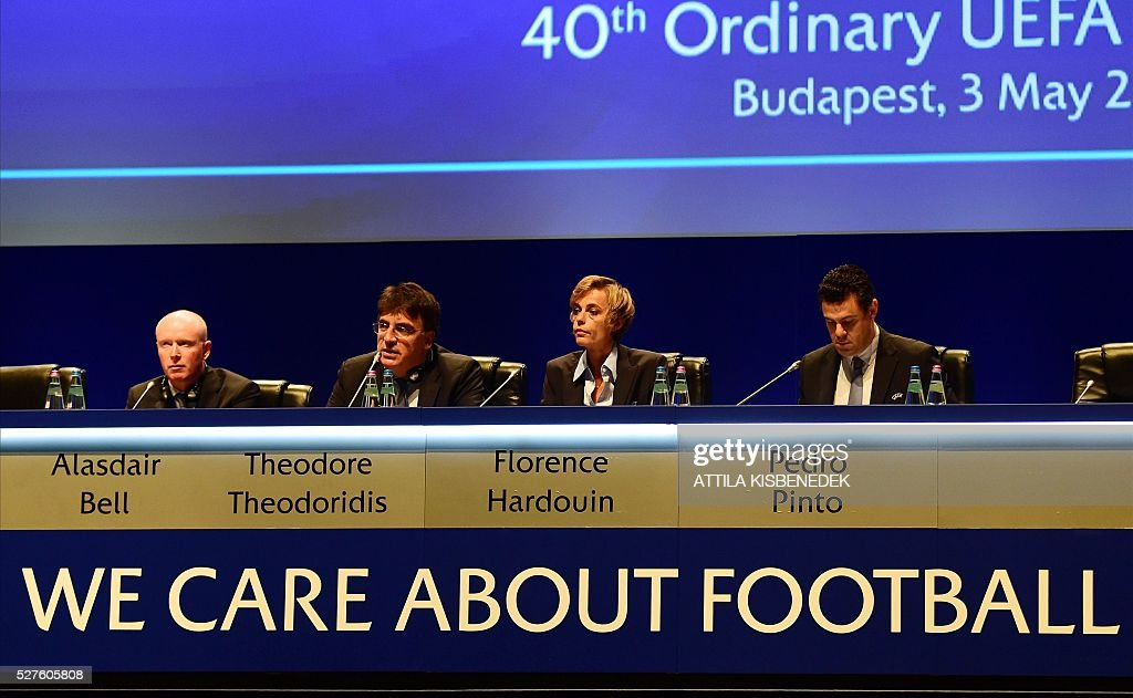 UEFA's Legal Director/General Counsel Alasdair Bell, French Football Federation (FFF) director general, Florence Hardouin, UEFA governing body's interim general secretary Theodore Theodoridis and UEFA's Chief of Press Pedro Pinto react during the press conference after Hardouin's admission in UEFAs Executive Committee, at the 40th Ordinary UEFA Congress in Hungexpo Fair Center of Budapest on May 3, 2016. UEFA elected Hardouin as its first female executive member in a landmark vote. / AFP / ATTILA