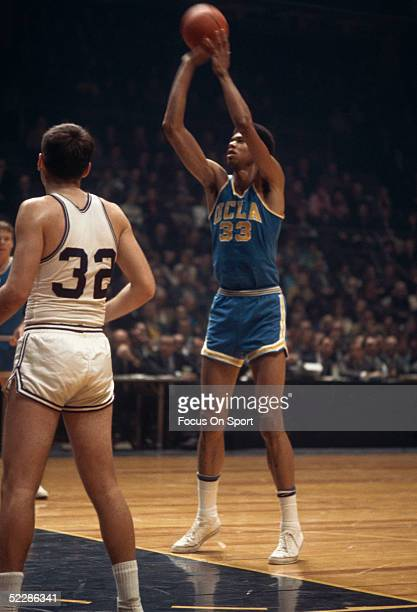 UCLA's Lew Alcindor shoots a free throw during a NCAA game in 1968