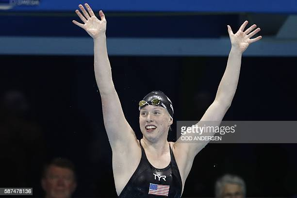 USA's Lilly King celebrates after she broke the Olympic record to win the Women's 100m Breaststroke Final during the swimming event at the Rio 2016...