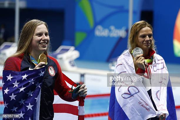USA's Lilly King poses with her gold medal next to silver medallist Russia's Yulia Efimova after she won the Women's 100m Breaststroke Final during...