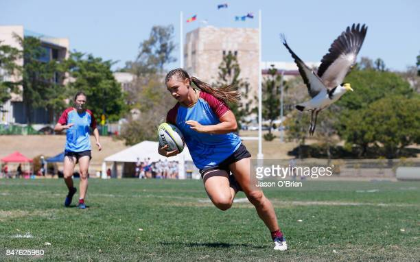 UQ's Lily Dick scores a try during the Women's University Sevens match between Queensland University and The University of Tasmania on September 16...