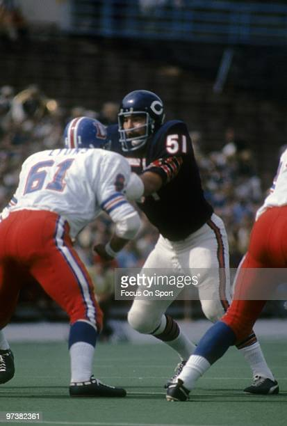 CHICAGO IL CIRCA 1970's Linebacker Dick Butkus of the Chicago Bears in action is blocked by guard Tommy Lyons of the Denver Broncos circa 1970's...