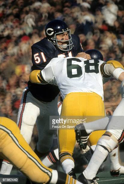 CHICAGO IL CIRCA 1970's Linebacker Dick Butkus of the Chicago Bears in action is blocked by guard Gale Gillingham of the Green Bay Packers circa...