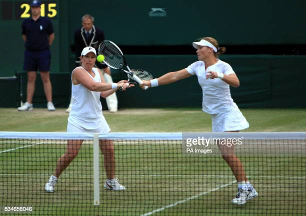 USA's Lisa Raymond and Australia's Samantha Stosur in action against USA's Serena and Venus Williams in the womens doubles final during the Wimbledon...