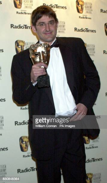 BBC2's Louis Theroux poses for the cameras after winning the Richard Dimbleby Award for Best Presenter an accolade he won for the second year running...