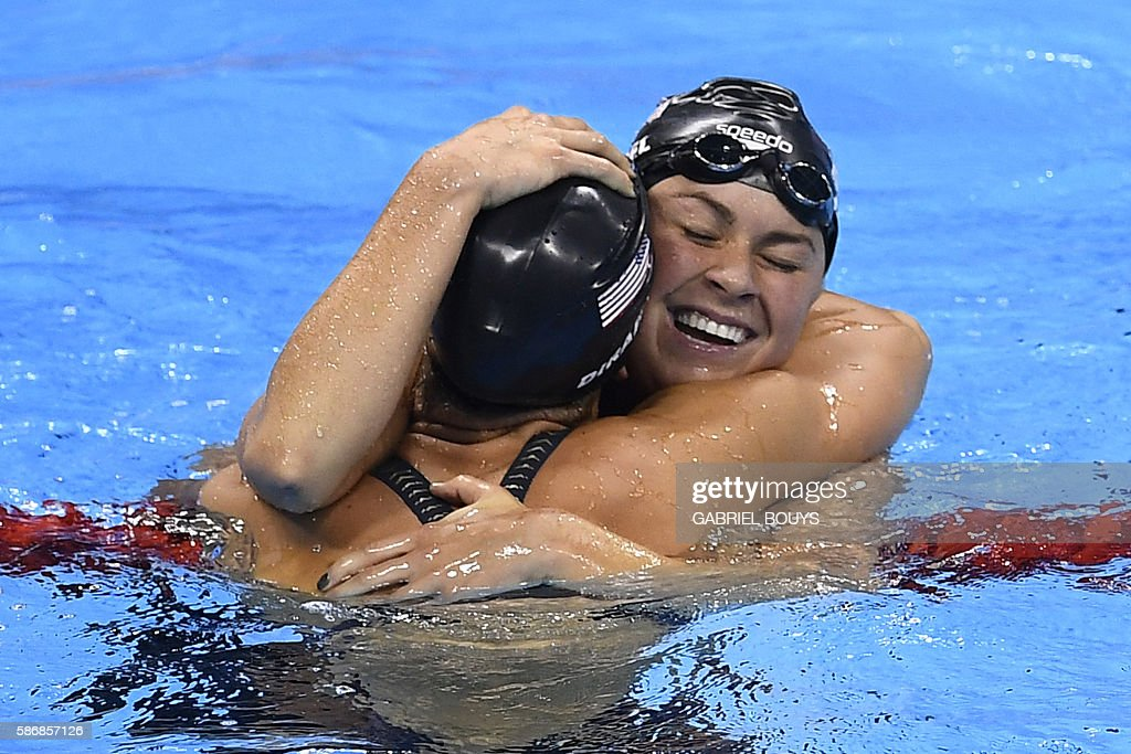 USA's Madeline 'Maya' Dirado reacts to winning silver with USA's Elizabeth Beisel after the Women's 400m Individual Medley Final during the swimming...