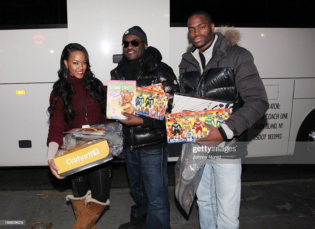 VH1's Malaysia Pargo, Glenn Toby and Olympic track star Samir Layne attend the Book Bank Foundation's 'Shelter From the Streets' holiday giving tour on December 20, 2012 in New York City.