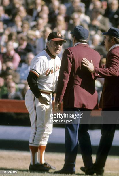 BALTIMORE MD CIRCA 1970's Manager Earl Weaver of the Baltimore Orioles arguing with two umpire during a early 1970's MLB baseball game at Memorial...
