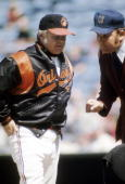 BALTIMORE MD CIRCA 1970's Manager Earl Weaver of the Baltimore Orioles discuss a call with the home plate umpire during a mid 1970's MLB baseball...