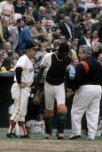 BALTIMORE MD CIRCA 1970's Manager Earl Weaver of the Baltimore Orioles talks with his catcher Ellie Hendricks during a early 1970's MLB baseball game...