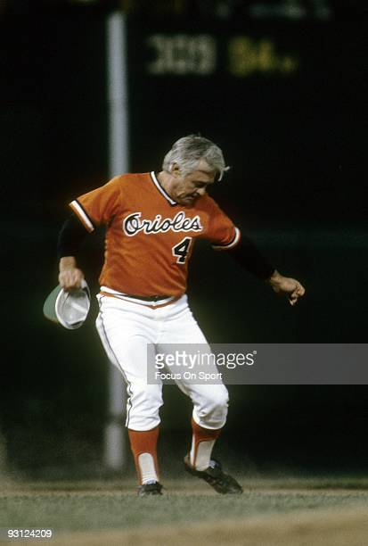 BALTIMORE MD CIRCA 1970's Manager Earl Weaver of the Baltimore Orioles upset at an umpires call kicks the dirt of the infield during a mid 1970's MLB...