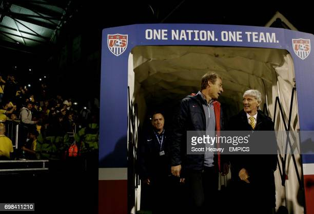 USA's manager Jurgen Klinsman and Colombia's manager Jose Nestor Pekerman walk out at Craven Cottage