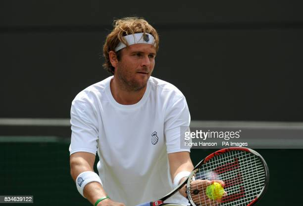 USA's Mardy Fish in action against France's Richard Gasquet during the Wimbledon Championships 2008 at the All England Tennis Club in Wimbledon