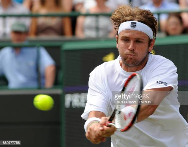 USA's Mardy Fish in action against France's Richard Gasquet