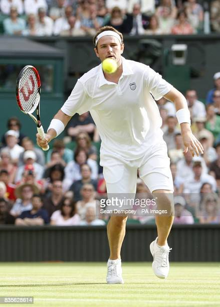 USA's Mardy Fish in action against Serbia's Novak Djokovic during the Wimbledon Championships 2009 at the All England Tennis Club
