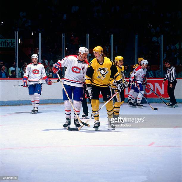 MONTREAL 1980's Mario Lemieux of the Pittsburgh Penguins shares a laugh with Larry Robinson of the Montreal Canadiens during the game