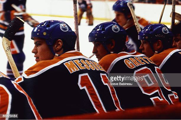 BOSTON MA 1980's Mark Messier and Wayne Gretzky of the Edmonton Oilers watch te play from the bench against the Boston Bruins at Boston Garden
