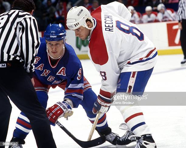 MONTREAL 1990's Mark Recchi of the Montreal Canadiens skates against Adam Graves of the New York Rangers during the 1990's at the Montreal Forum in...