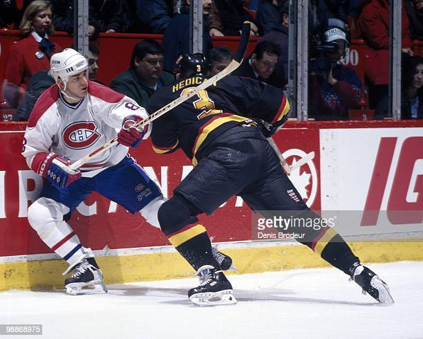 MONTREAL 1990's Mark Recchi of the Montreal Canadiens skates against Bret Hedican of the Vancouver Canucks during the 1990's at the Montreal Forum in...
