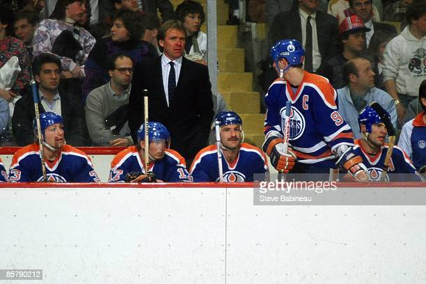 BOSTON MA 1980's Marty McSorley Jari Kurri Glenn Anderson Wayne Gretzky Mark Messier and coach Glen Sather of the Edmonton Oilers all on the bench...