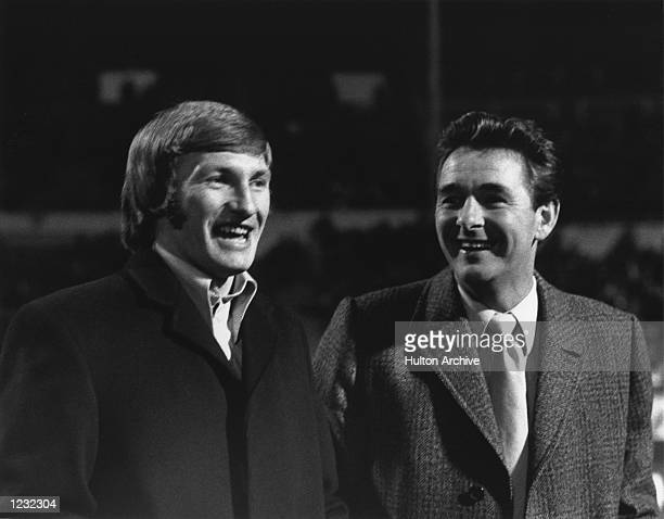 SHARES A JOKE WITH COLIN TODD ON THE PITCH AT WEMBLEY STADIUM FOR ENGLAND's MATCH AGAINST POLAND Mandatory Credit Allsport Hulton/Archive