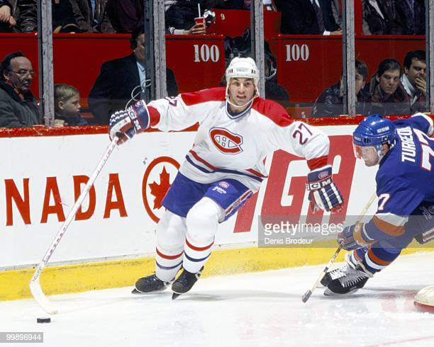 MONTREAL 1990's Mathieu Schneider of the Montreal Canadiens skates against Pierre Turgeon of the New York Islanders during the 1990's at the Montreal...