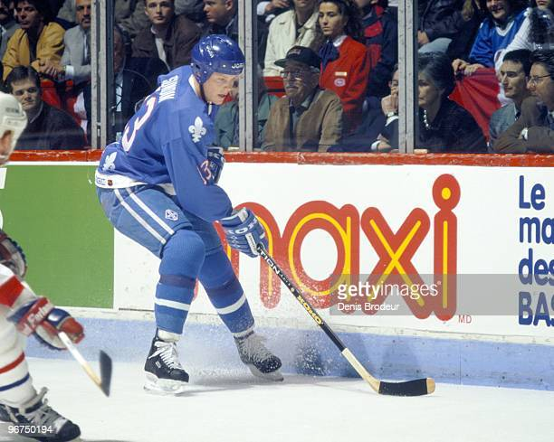 MONTREAL 1990's Mats Sundin of the Quebec Nordiques skates with the puck along the boards against the Montreal Canadiens in the early 1990's at the...