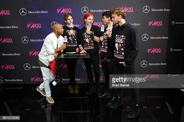 Z100's Maxwell Jones with Luke Hemming Michael Clifford Calum Hood and Ashton Irving of 5 Seconds of Summer attend Z100's Jingle Ball 2015 at Madison...